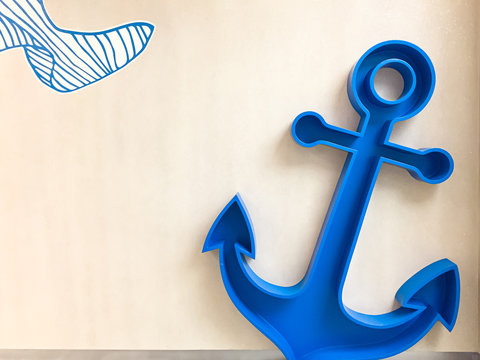 Big blue anchor for kid with wooden background.