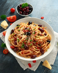 Pasta Alla Puttanesca with garlic, olives, capers, tomato and anchois fish