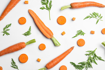 Fototapete - Tasty ripe carrots and leaves isolated on white, top view