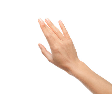 Young woman held out hand on white background, closeup