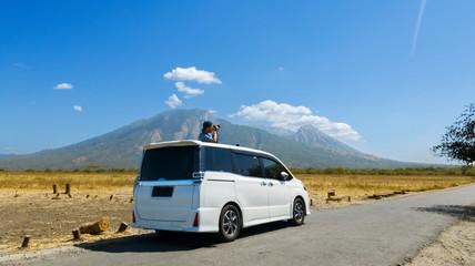 Photographer taking photos Baluran mountain view