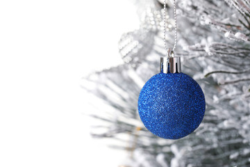 Fotobehang - Beautiful Christmas tree with festive decor on white background, closeup