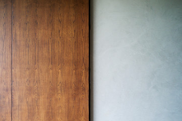 Abstract texture and background of sliding wooden door and cement wall.