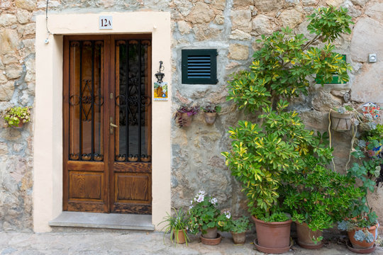 Valldemossa. Entrance door to the house decorated with flower pots