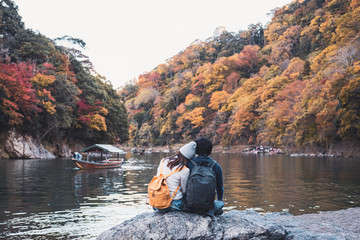 Young couple traveler looking beautiful landscape at arashiyama Japan, Travel lifestyle concept