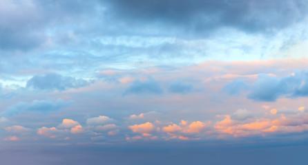 Romantic sundown sunrise sky with colorful clouds