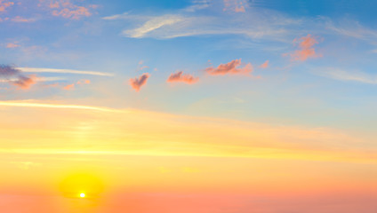 Real sunrise sundown sky with sun and colorful clouds Wall mural