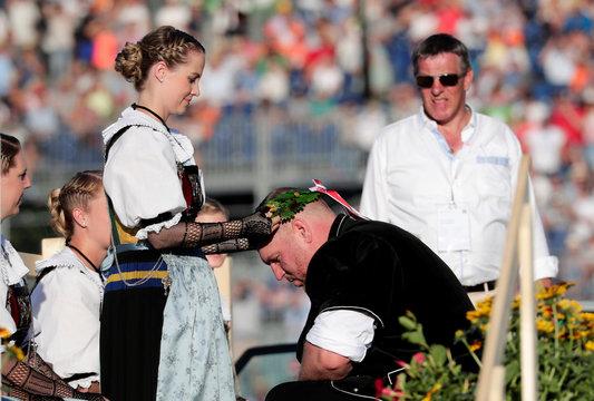 Winner Christian Stucki receives a wreath at the ceremony, during the ESAF-Federal Alpine Wrestling Festival (Eidgenoessisches Schwing- und Aelplerfest) in Zug