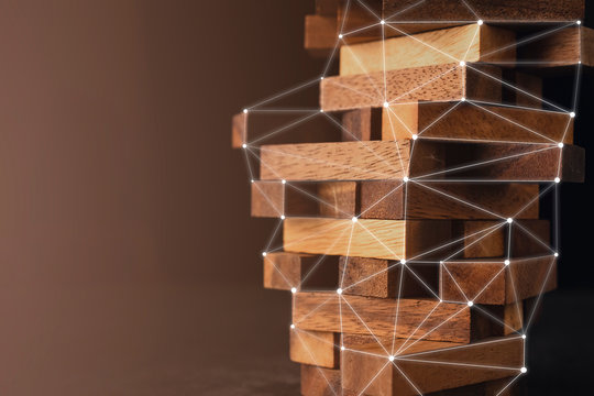 business organize  management strategy ideas concept wood stack block tower arranging with dark background
