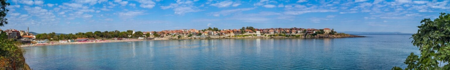 Seaside landscape, panorama, banner - view of the embankment with fortress wall and beach in the city of Sozopol on the Black Sea coast in Bulgaria Wall mural