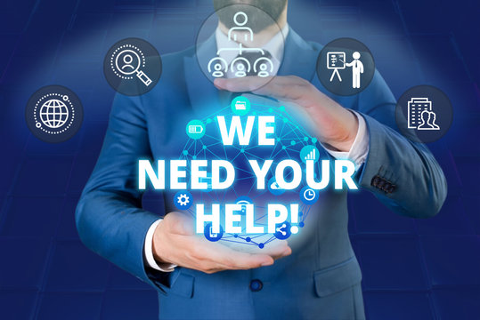 Writing note showing We Need Your Help. Business concept for asking someone to stand with you against difficulty Male human wear formal work suit presenting using smart device