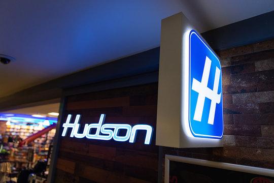 Seattle, Washington - August 23, 2019: Hudson store logo on sign at Seatac International Airport in Seattle, Washington