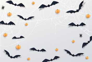 Halloween decor with black bats, dark scary spider, pumpkin, white cobweb in paper cut style. Top view. Copy space at the centre