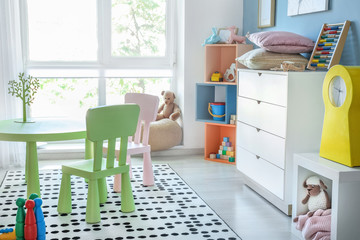 Stylish interior of modern playroom in kindergarten