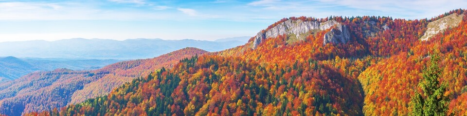 great view of carpathian mountain landscape.  wonderful afternoon panorama of apuseni natural park. trees in fall foliage. rocks on the hill top. pietrele negre located in bihor country, romania