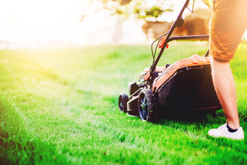Close up details of industrial lawnmower, machinery. Gardening details and landscaping.