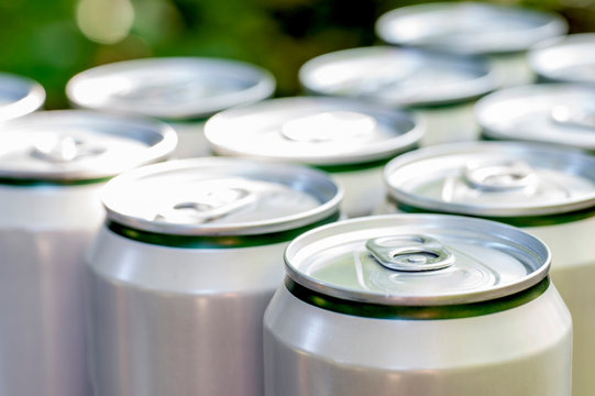 Aluminum closed white cans with beer close-up