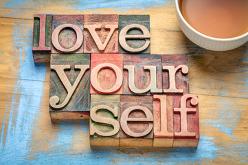 love yourself word abstract in wood type, self respect concept