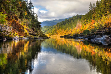 A rainbow of fall colors is reflected in the smooth Rogue River while white water rafting with some amazing friends