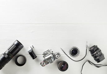 Retro analog film camera with lenses and photography equipment on white wooden background with copy space - photography or creativity concept, flat lay top view from above Fototapete