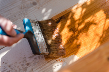 Paint the porch with orange paint. Decorate the terrace. Paint the boards with a wide brush. To make repairs.
