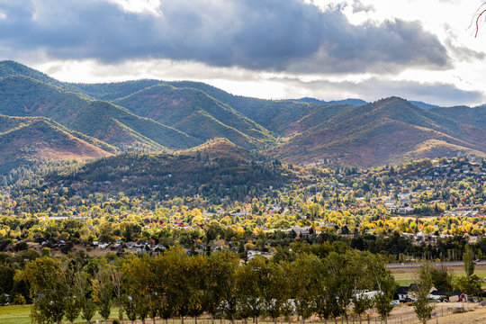 Big clouds cast striking shadows over fall colors near Ashland Oregon
