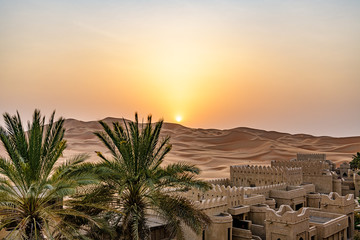 Tuinposter Diepbruine Qasr Al Sarab in Liwa, Al Dhafra, Abu Dhabi, United Arab Emirates at sunset