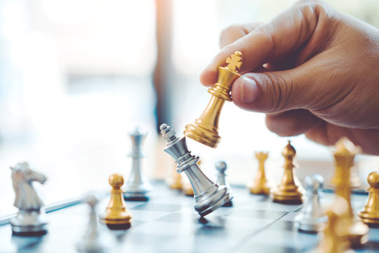 Businessman playing chess game Planning of leading strategy successful business leader concept