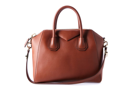 Brown color luxury fashion bag on background