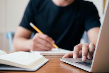 Closeup man hands using computer laptop.