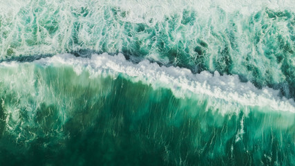 Aerial wave background. Drone shot directly from above, green turquoise color, huge waves. Empty...