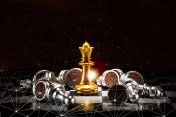 gold queen chess surrounded by a number of fallen silver chess pieces and abstraction connection line network screen , business strategy concept