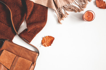 Autumn composition. Sweater, plaid, autumn leaves on white background. Flat lay, top view, copy...