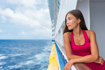 Wall Mural - Luxury travel cruise vacation Asian elegant lady on holiday ship in Caribbean destination getaway. Tourist girl in red dress on deck looking at ocean.