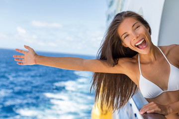 Wall Mural - Cruise vacation on cruise travel holiday in caribbean beach. Asian girl with open arm in freedom happy excited. Tourist woman screaming of joy. Happy traveler having fun on summer vacations.