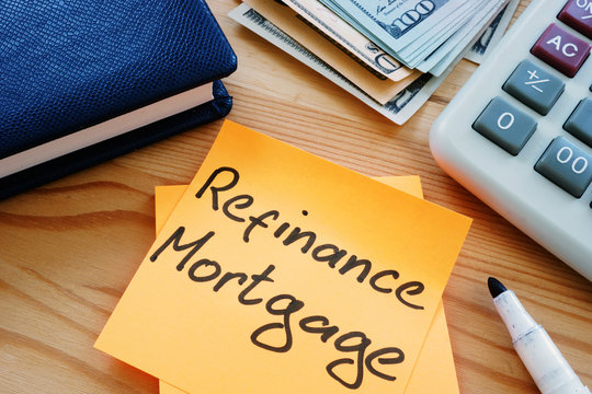 Text sign showing hand writed words refinance mortgage