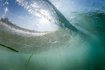 Underwater view of a wave breaking  Wall mural