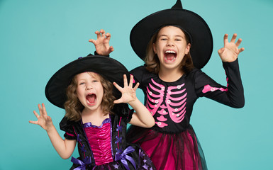 little witches on turquoise background. Wall mural