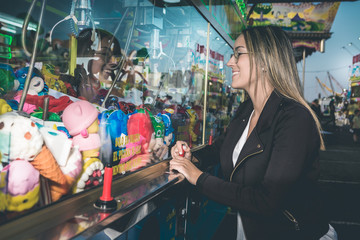 woman playing at the fairground attraction
