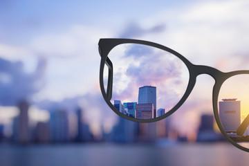 Modern bright city view through eyeglasses