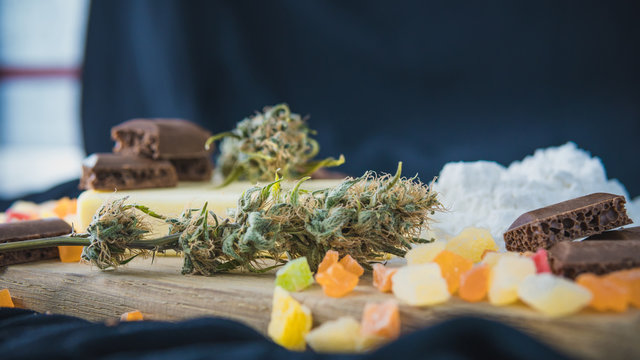 Preparing to cooking cake with cannabis butter. Concept of using marijuana in food industry.