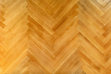Wooden floor with herringbone pattern top view