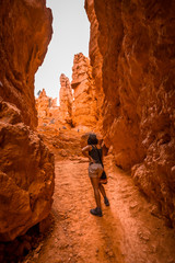 A young woman starting the rise of the Navajo Loop Trail in Bryce National Park, Utah. United States