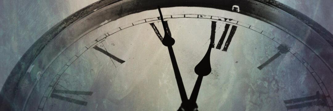 Panoramic image Retro clock with five minutes before twelve