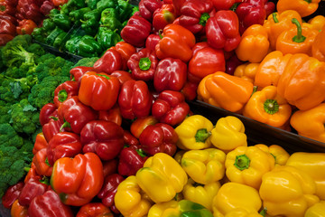 colorful bell and sweet peppers in the store shelf