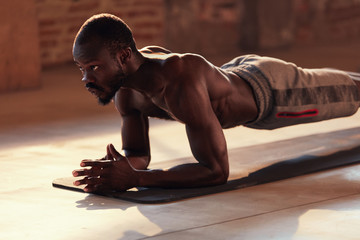Sport man doing plank exercise on fitness workout at gym
