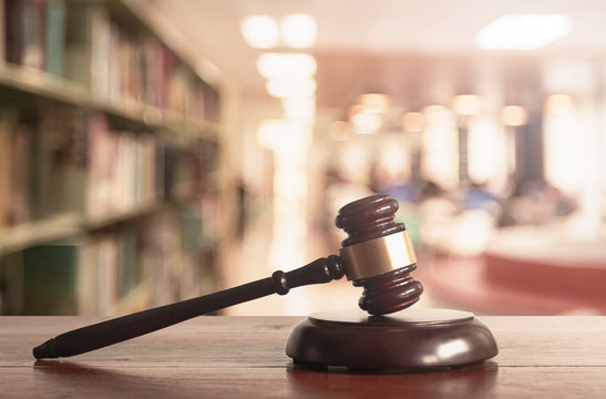 Justice gavel on blurred library background