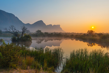 Foto op Canvas Afrika Magic sunrise landscape inside the Entabeni Safari Game Reserve with the Hanglip or Hanging Lip mountain peak, Waterberg, Limpopo Province, South Africa.