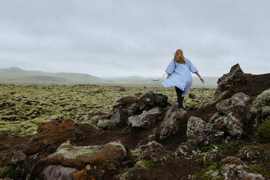Young beautiful woman in an old moss-covered lava field  volcanic area in Iceland. Amazing nature