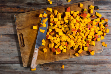 Overhead view of chopped squash on cutting board